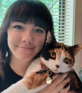 Hannah and her cat, Kiki.